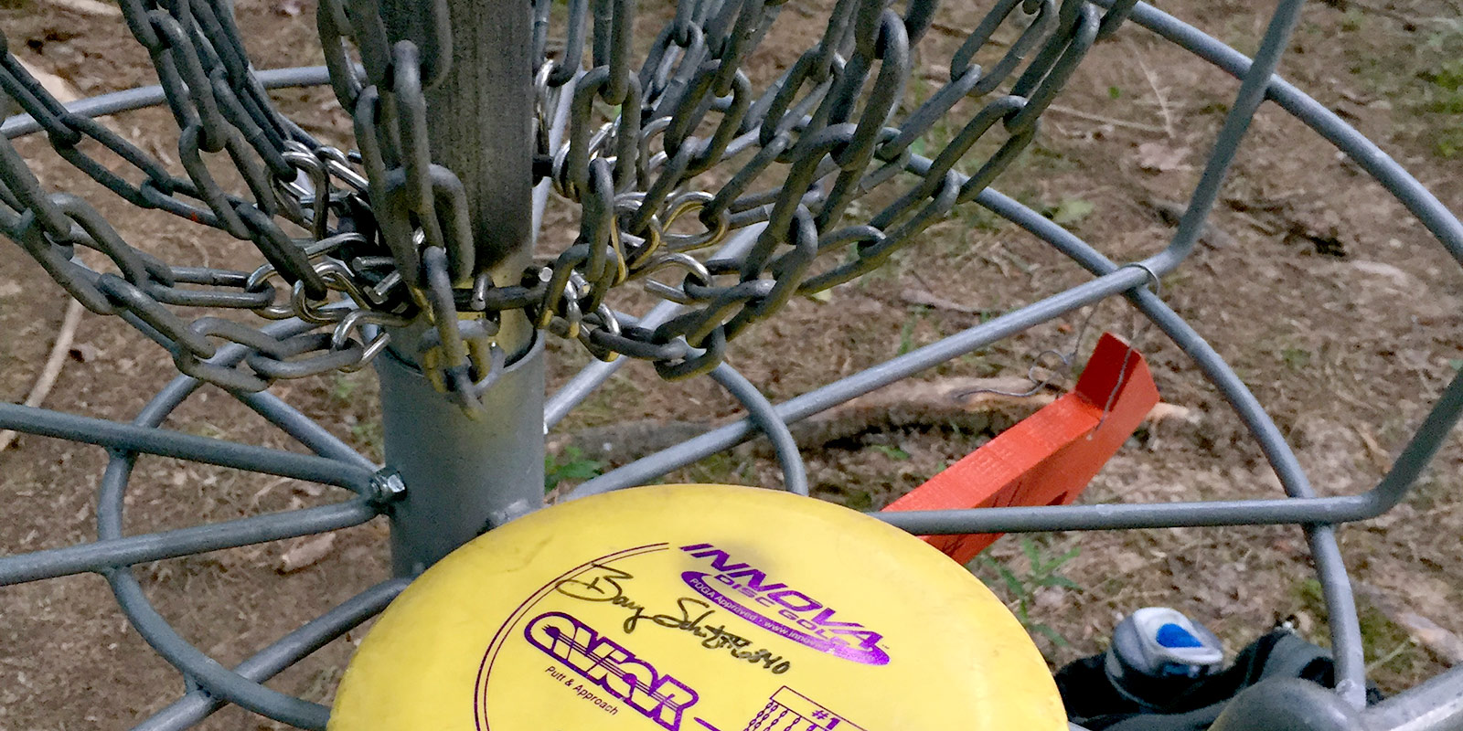 disc golf disc in a basket